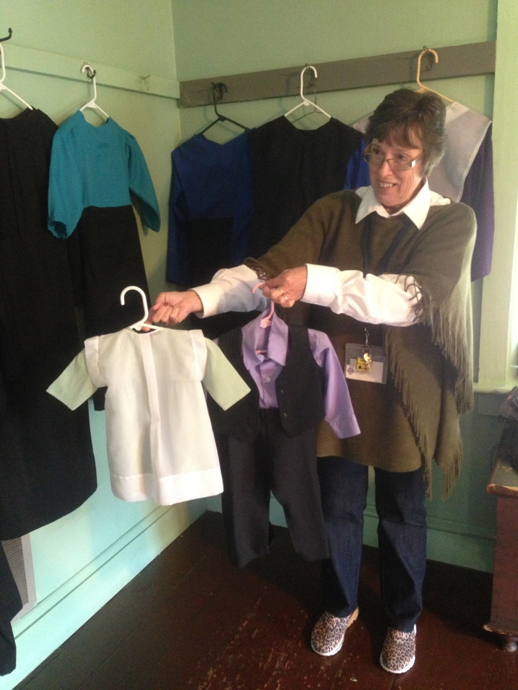 our nice tour guide holding some Amish clothings