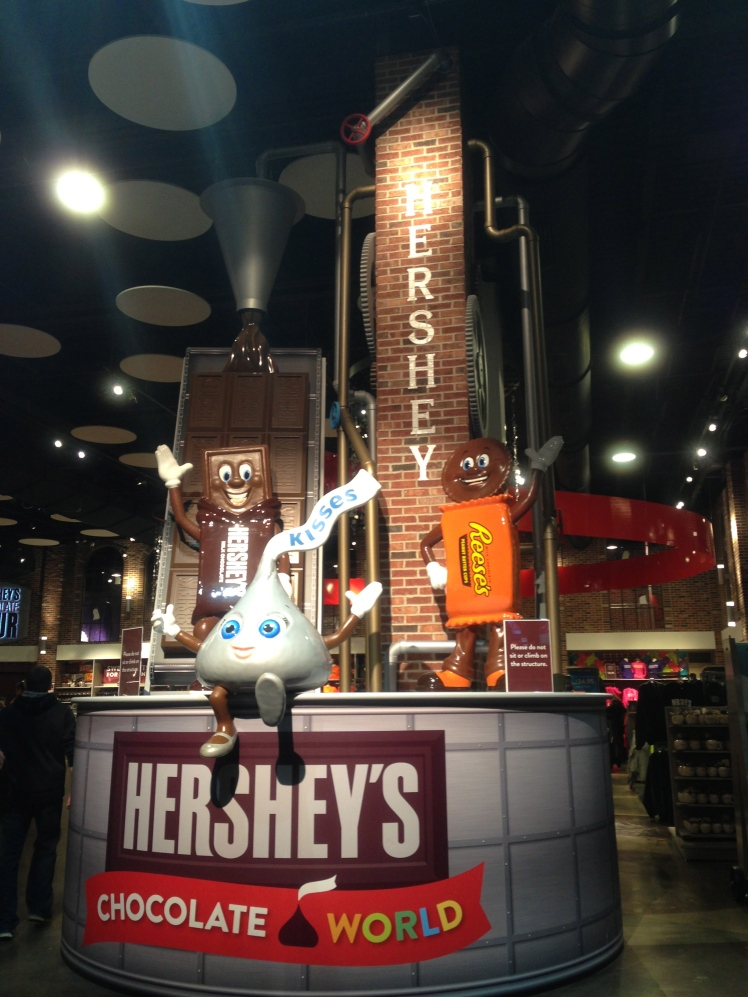 Behind these cute hershey's statues are the store of Hershey's cute and fun stuff